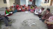 Villagers sit in discussion