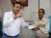 Mr. Aksat Gupta giving prize to Mr. Godhan Singh