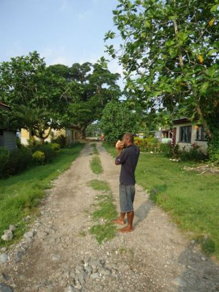 The village headman of Naqaravutu village blows a conch shell to herald the arrival of the COMDEKS team and summon villagers to a village meeting. Community consultations and a baseline assessment were conducted by COMDEKS grantee Birdlife International in early 2013.