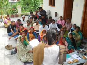 residents meet for village discussion.