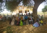 Community members meet outside the headquarters of the municipality of Tabalak to discuss development of the Landscape Strategy for Niger